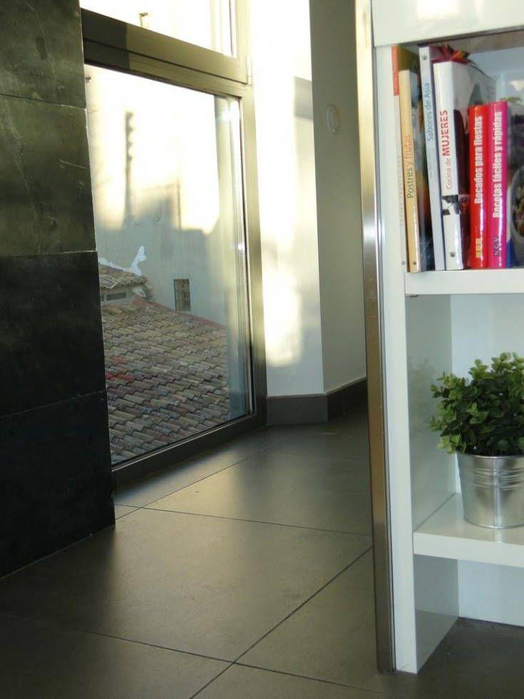 Reforma de atico duplex con terraza en el ensanche de valencia for Carpinteria de aluminio